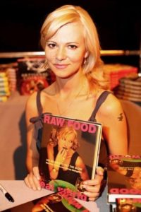 Sarma with her cookbook (used with permission)